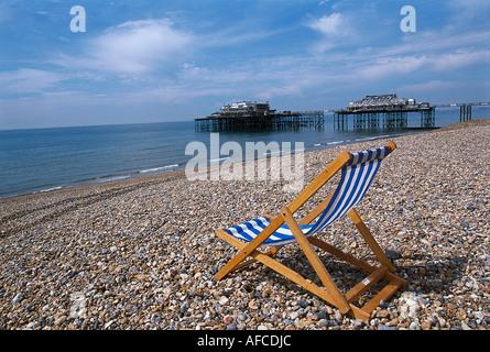 Beach Chair, West Pier, Brighton, East Sussex England - Stock Photo