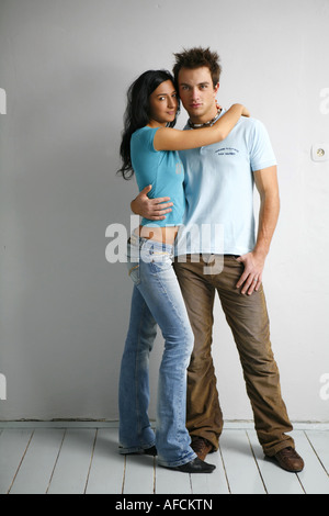 Portrait of young couple - Stock Photo