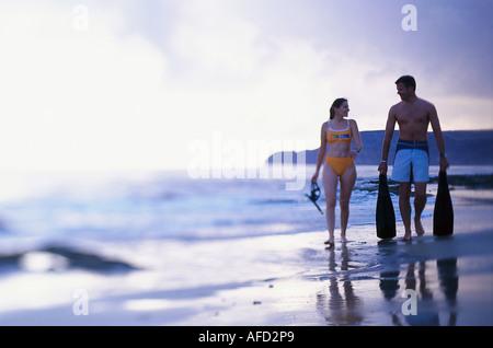Couple at a beach, Porto Santo, Madeira, Portugal - Stock Photo