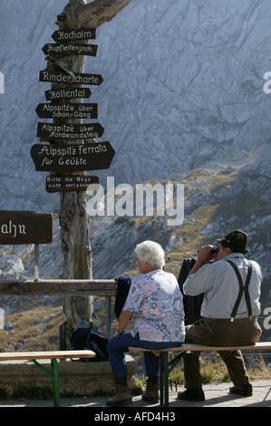 Tourist couple on Hausberg, Garmisch, bavaria, germany - Stock Photo