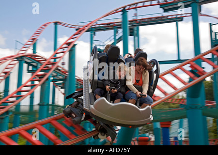 Riders on roller coaster at Alton Towers, Staffordshire, UK - Stock Photo