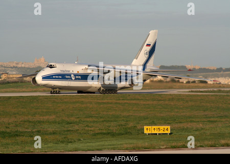 Air freight transport. Antonov An-124 Ruslan heavy cargo jet operated by Volga-Dnepr Airlines taxiing for departure - Stock Photo