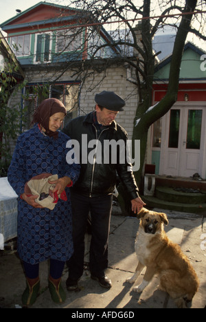 Ukraine Brovari former collective farm now privatized corporation manager mother dog home - Stock Photo