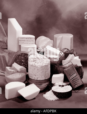 English Cheeses in group Sepia toned photograph on warm toned mottled background, studio tabletop.  Vertical Format. - Stock Photo