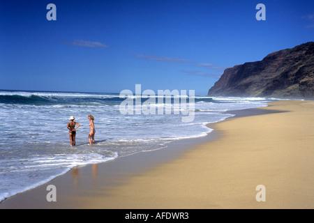 Women on Kauai Beach, Barking Sands Beach, Polihale State Park, Kauai, Hawaii, USA - Stock Photo