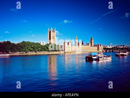 Wide angle view of the Houses of Parliament (Palace of Westminster) from south side of River Thames - Stock Photo