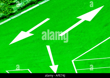 Asphalt roadway with direction arrows - Stock Photo