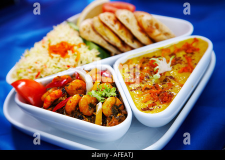 Indian Curry set meal curried prawns,sag, naan bread and rice. - Stock Photo