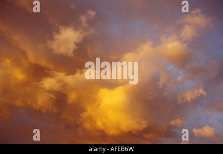 moody yellow and blue evening sky - Stock Photo