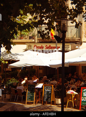 Street Cafe and Tapas Restaurant Scene Tourists and locals Town of Soller The Tramuntana Region Majorca Balearic - Stock Photo