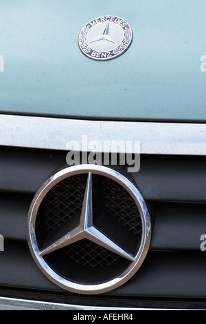 Mercedes car badge displayed on bonnet and radiator grill - Stock Photo