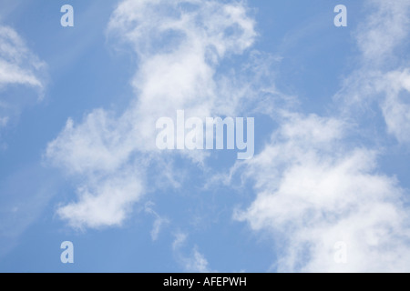 Clouds in a clear blue sky scene - Stock Photo
