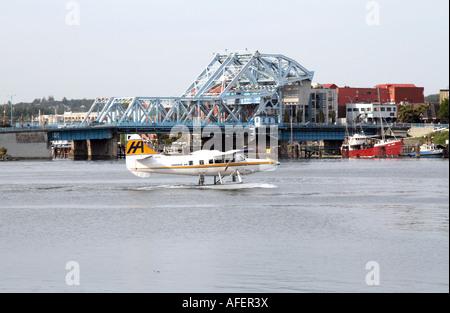 Float Plane taxis past the Johnson Street Bridge, Victoria, British Columbia, Canada - Stock Photo