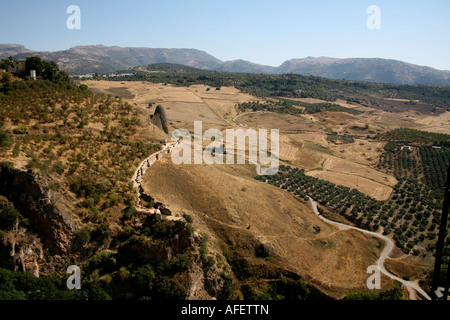 Sunny scenic landscape view of mountains and agricultural fields in valley, Ronda, Southern Spain - Stock Photo