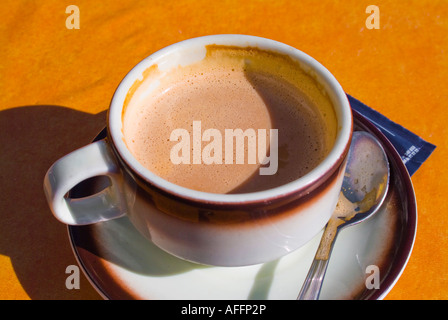 Cafe latte in cup on restaurant table - Stock Photo