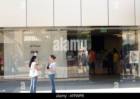 Customers visit the Apple store in Santa Monica, California where they can buy everything from a new iPhone to iPods - Stock Photo
