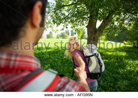 A couple holding hands. - Stock Photo