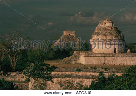 MEXICO Yucatan Chichen Itza Maya observatory called El Caracol At the background El Castillo pyramid called Kukulkan - Stock Photo