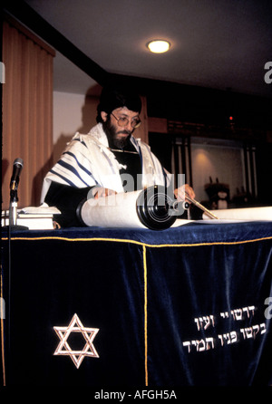 A rabbi reads from the scrolls in a Jewish reformed synagogue London - Stock Photo
