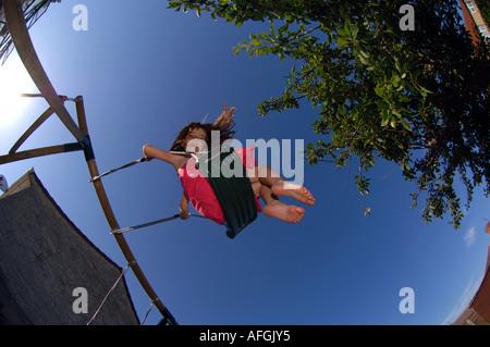 Swing, Girl on a swing - Stock Photo