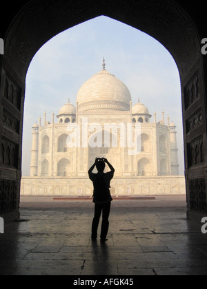 East front of the Taj Mahal with inlays carvings engravings seen from the jawab building in Agra in Uttar Pradesh - Stock Photo