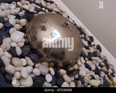 ... Indoor Water Fountain With Chrome Fountain Head And Black And White  Pebbles   Stock Photo