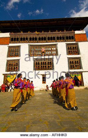 Women performing at the Paro Tsechu festival Paro Bhutan - Stock Photo