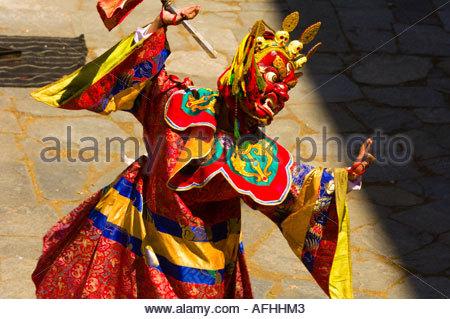 Masked dancers performing the Dance of the Terrifying Deities at the Paro Tsechu Festival Paro Bhutan - Stock Photo
