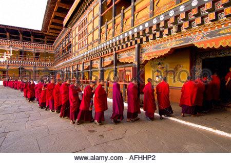 Monks in procession at the Paro Teschu festival Paro Dzong Monastery Paro Valley Bhutan - Stock Photo