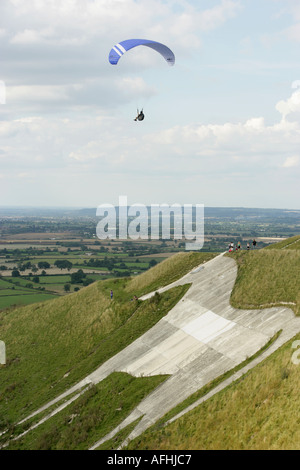 Paraglider flying from Westbury White Horse Wiltshire - Stock Photo