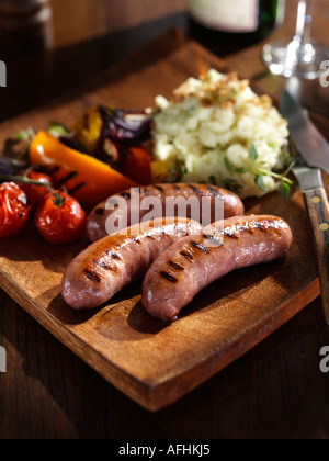 Char grilled sausages - Stock Photo