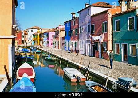 Colourful former fishermen s cottages beside a canal on the island of Burano Venice Italy - Stock Photo