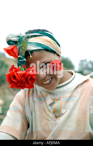 Berber girl with flowers in her hair near Ouirgane Nfis gorges High Atlas Morocco North Africa - Stock Photo