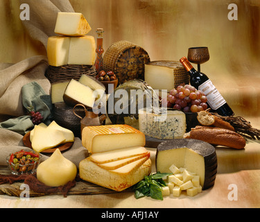 Spanish Cheeses in group color photograph on tan toned mottled background. Horizontal  Format, studio tabletop. - Stock Photo