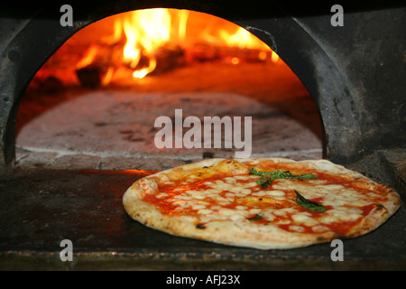Just cooked Pizza from a real fire oven in Naples Italy - Stock Photo