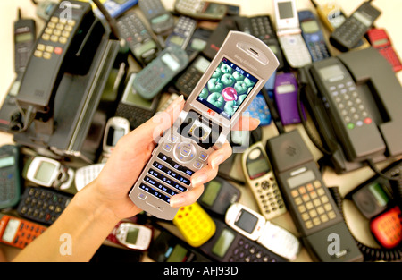 Vodafone shows off 20 years of mobile phone styles from 1984 to 2004 - Stock Photo