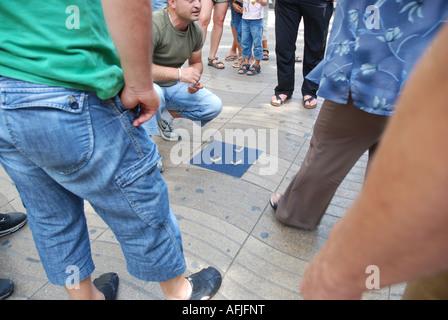 forbidden street gambling Ramblas Barcelona Spain - Stock Photo