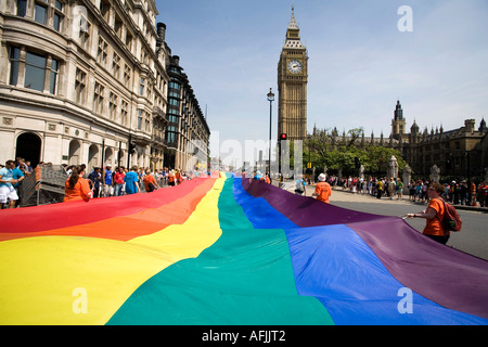 Giant rainbow flag floating at Parliament square during the Gay Pride parade London, England, Britain, UK. - Stock Photo