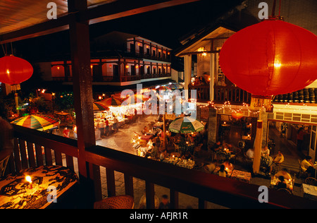 Restaurants and cafes crowd the rid of streets in Central Yangshuo, the usual terminus of celebrated boat-trips - Stock Photo