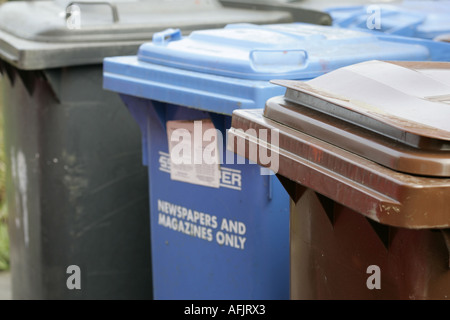 A selection of waste bins including refuse paper recycling blue and garden waste recycling bin brown for a household - Stock Photo
