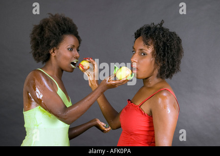 Rosh Hashanah Jewis new year symbols. Two Ethiopian Jews with apples and honey - Stock Photo