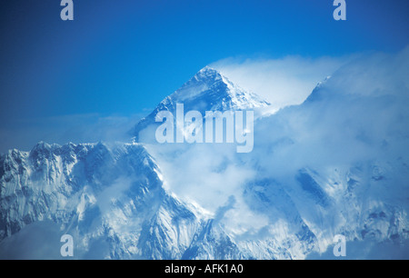 Mount Everest summit Nuptse aerial view taken from cockpit of small jet Nepalese Himalayas Nepal Asia - Stock Photo