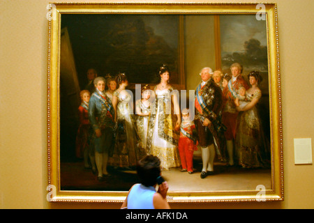 Madrid Museo del Prado Museum and Art Gallery tourist admires Charles IV and family by Goya Madrid Spain Espana - Stock Photo