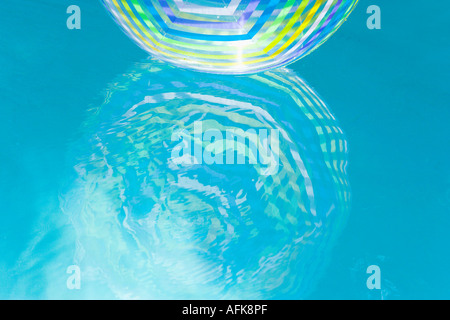 Pool Water With Beach Ball beach balls in a blue swimming pool stock photo, royalty free