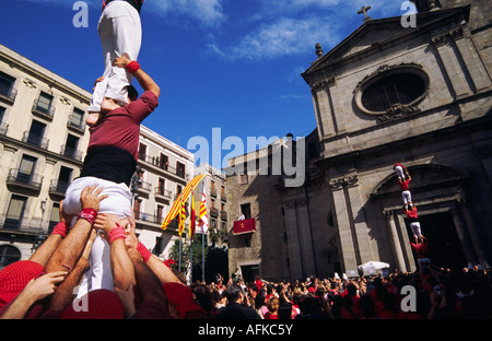 Teams of castellers build human towers during the festival of La Merce in Barcelona. - Stock Photo
