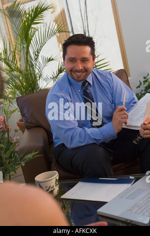 Real estate agent giving a presentation - Stock Photo