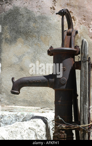 Old water pump at the Church of the Holy Sepulchre Old city Jerusalem Israel - Stock Photo