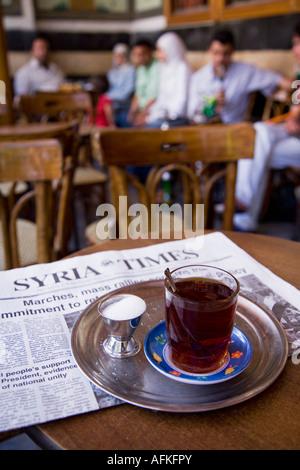 Drinking tea in the famous Al Nawfara cafe in Old Damascus, Syria - Stock Photo