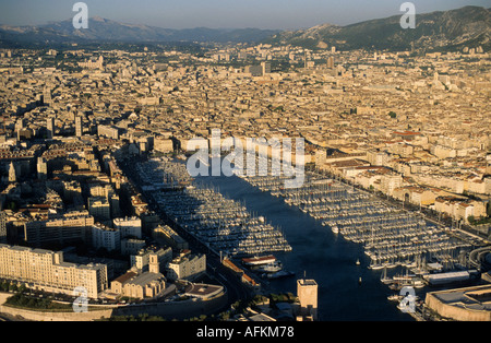 The Old Port (Vieux Port) and the city of Marseille, France - at dusk. - Stock Photo