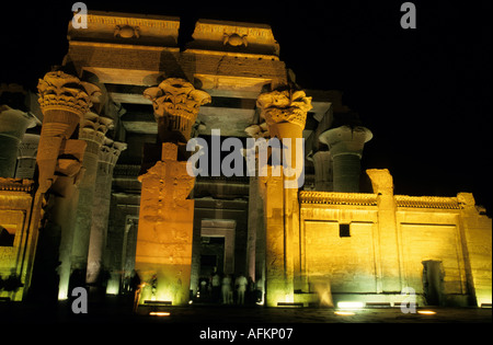 Entrance to The Temple of Kom Ombo, dedicated to the gods Sobek and Haroeris illuminated at night, Kom Ombo, Egypt. - Stock Photo